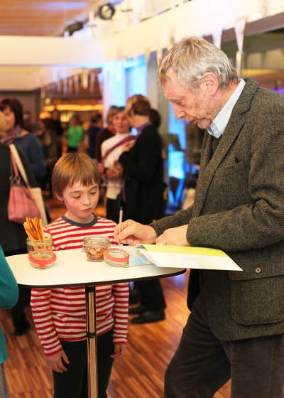Michael Rosen signs a copy of We're Going on a Bear Hunt